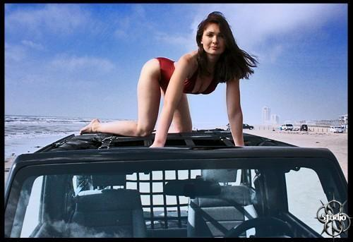 Hot Girl on top of a Jeep!  They should come standard with one!