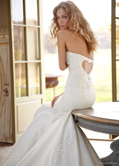 weddinginspirasi:  Hayley Paige Spring 2012 Gracie strapless fit-to-flare silk organza embroidered bridal gown with scattered flowered motifs and heart-shaped cutout at the back.