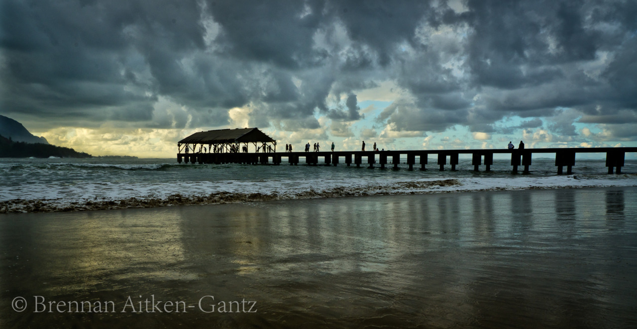 Hanalei bay pier cloudy sunset.