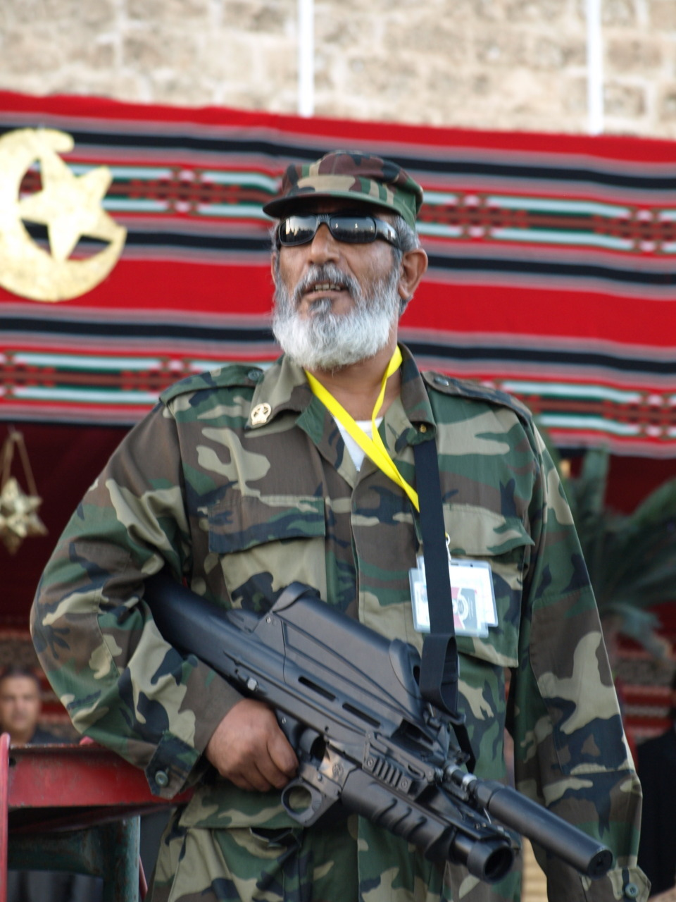 Photo of the day: A Libyan rebel with… a FN F2000 (equipped with noise suppressor and LG1 grenade-launcher).  This picture was taken on the Friday of Victory, in October 2011, on Martyrs Square, Tripoli.  Photo by Raphael Thelen - www.RaphaelThelen.de