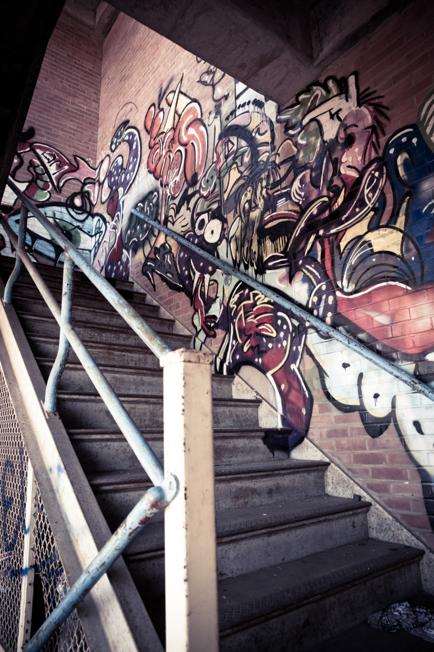 Graffiti lines the stairwell in this abandon psychiatric hospital in Northiville Michigan.