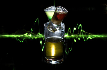 "The Frag Grenade (Call of Duty: Modern Warfare cocktail) Ingredients: LimoncelloCrème de MenthJagermeisterBaileysEnergy drinkBlack vodka Directions: ""Not so much a cocktail as a military exercise, this mission features two shooters colliding in an energy drink combat zone. Start by making a Soap MacTavish – get a shot glass and pour in limoncello, then Crème de menth. Now concoct a ""Jagernaut"", which is Jagermeister, then Baileys in another shot glass. Now get a half-pint glass and fix a ""Makarov"" – pour in your energy drink of choice, plus a shot of Black vodka. Now, wedge your two shooters in the mouth of the half-pint glass. Your first step is to pull the pin on the Soap Mactavish, by carefully yanking the glass free and downing the shooter. This will of course, result in your Jagernaut depth charging into the Makarov – now drink the resulting combination. That's right, it's the ultimate shooter-'em-up."" Earn maximum experience points by priming and consuming this explosive concoction. Drink created by James Dance of Loading for an article in The Guardian. Check out the article for the rest of the drinks and check out Loading for a great gaming bar and cafe."