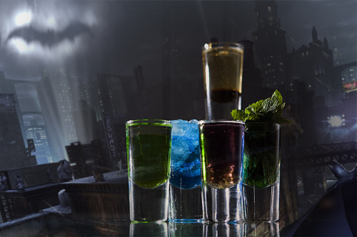 "Batman: Arkham Party (Batman: Arkham City shot set) Ingredients:MidoriVodkaCrushed iceBlue CuracaoSambucaCranberry juiceRum popping candyFresh Mint sugar syrupBlackcurrant coulis (you can buy this in bottles or jars if you don't want to make your own)Champagne Directions: ""This shot set sees some of Gotham's most dastardly villains taking on the Dark Knight. For The Riddler, pour 20ml of Midori down the inside of glass, then add 5ml of vodka over a spoon. For a Mr Freeze, crush some ice and pour it into your shot glass, followed by 10ml of Blue Curacao and 10ml of Sambuca. Your Joker is made from 15ml Blue Curacao, cranberry juice and rum with a topping of popping candy (""You'll need to stir it up with a straw to get the colour,"" says James). Then we have a Poison Ivy, grown from 15ml of rum, a fresh mint leaf (or a dash crème de menth if you prefer) and sugar syrup. Finally, create your Batman/Bruce Wayne shooter with 5ml of blackcurrant coulis and champagne. Now let the flavour battle commence!"" The caped crusader better have some paracetamol in that utility belt – this isn't so much a cocktail as a super villain fist fight. Drink created by James Dance of Loading for an article in The Guardian. Check out the article for the rest of the drinks and check out Loading for a great gaming bar and cafe."
