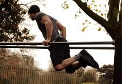 Bodyweight dips.  Leaning forward emphasizes the chest.  Keeping your body vertical emphasizes the triceps.