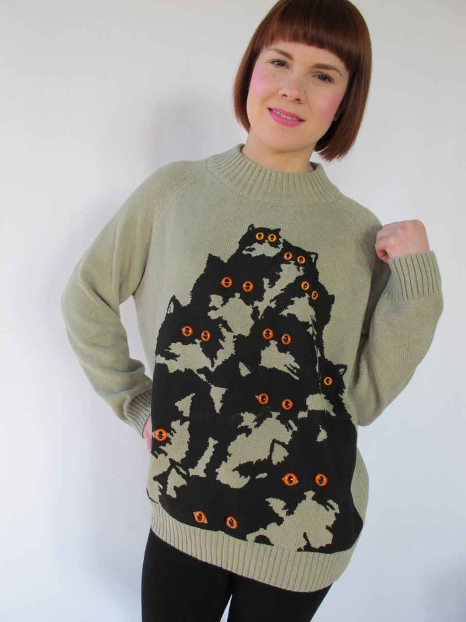 super nice sage green cotton sweater with neon orange kitty eyes! meow! http://www.etsy.com/shop/PrettySnake