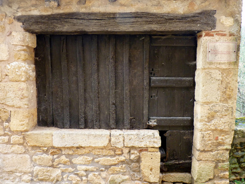 medievallove:  Medieval store front, Limeuil, France. One particularity of these little shops, is that anything you had to try on was done in the street. by montestier on Flickr.