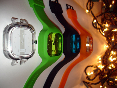 My Modify Watches collection. It is a small collection consisting of a Black, Green and Orange Strap to go with a White, Green, Blue and Silver Face.