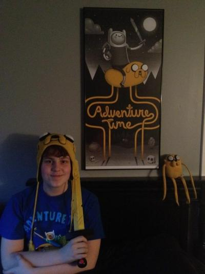 adventuretime:  chanthehuman:  My poster is finally here!! I got it custom framed and now it hangs proudly over my bed. Really amazing poster!  Chandler with one of the now rare Adventure Time posters from Mondo. Limited edition of 220. Designed by Mike Mitchell.