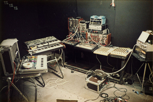 bricolagerainbow:   One of a couple of very rare shots of my equipment at the Industrial Records studios in Hackney, London - sometime in 1980. Roland SH-7 SynthRoland CSQ-600 Digital SequencerRoland TR-808 Drum MachineRoland SRE-555 Chorus Echo (flight-cased)Roland 181 Controller KeyboardRoland 100M 190 containing two 182 Analogue Sequencers  Roland 100M 191-J containing various Roland modulesRoland 100M 191-J containing self-built Digisound modulesRoland 100M modules x2 freestandingSeck 6-2 mixers x2Self-built Digital DelaySelf-Built 11-Band Graphic EqualiserSelf-Built dual phaser/flanger unitBoss BF-1 Flangers x2Boss KM-4 MixerBoss MA-1 Mascot AmpAccessit Spring ReverbTEAC Cassette DeckJVC AmplifierJVC Portable Pro cassette deck TG EM Box Flight-case containing:Eventide HarmonizerSelf-built Harmonizer sample trigger controllerSerge Modified Casio MT30 keyboardBoss DS1 DistortionBoss BF1 FlangerBoss CE1 ChorusBoss KM-04 MixerBOSS MA-5 Micro Monitor