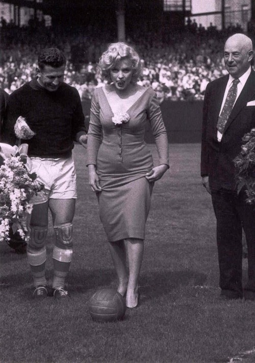 Marilyn Monroe giving an honorary kick at the soccer game between USA and Israel. [May 12, 1957]