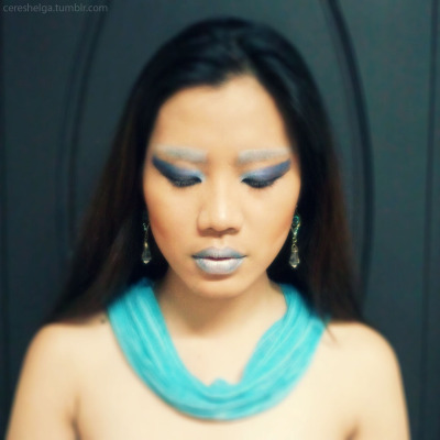 Ice Queen.Points for this look:- used 7 hues, including the eyebrows and lips- used a little cardboard as guide for sharper edges in the eye makeup and cheek contours.- used 2 hues of eyeshadow again on the lips for a more solid look.Model: StephMakeup by me. :)