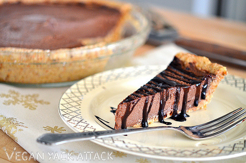Raw Chocolate Mousse Pie with Rich Chocolate Drizzle Are you trying to eat more raw foods for the new year? Worried at all about craving desserts that won't leave you satisfied? This dessert is the solution for you! Get the recipe at Vegan Yack Attack!