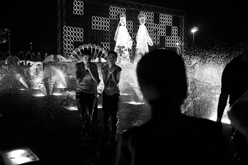 MEDELLIN. Kids playing around Las Alumbrados, lights decorating Medellin over the Christmas period.
