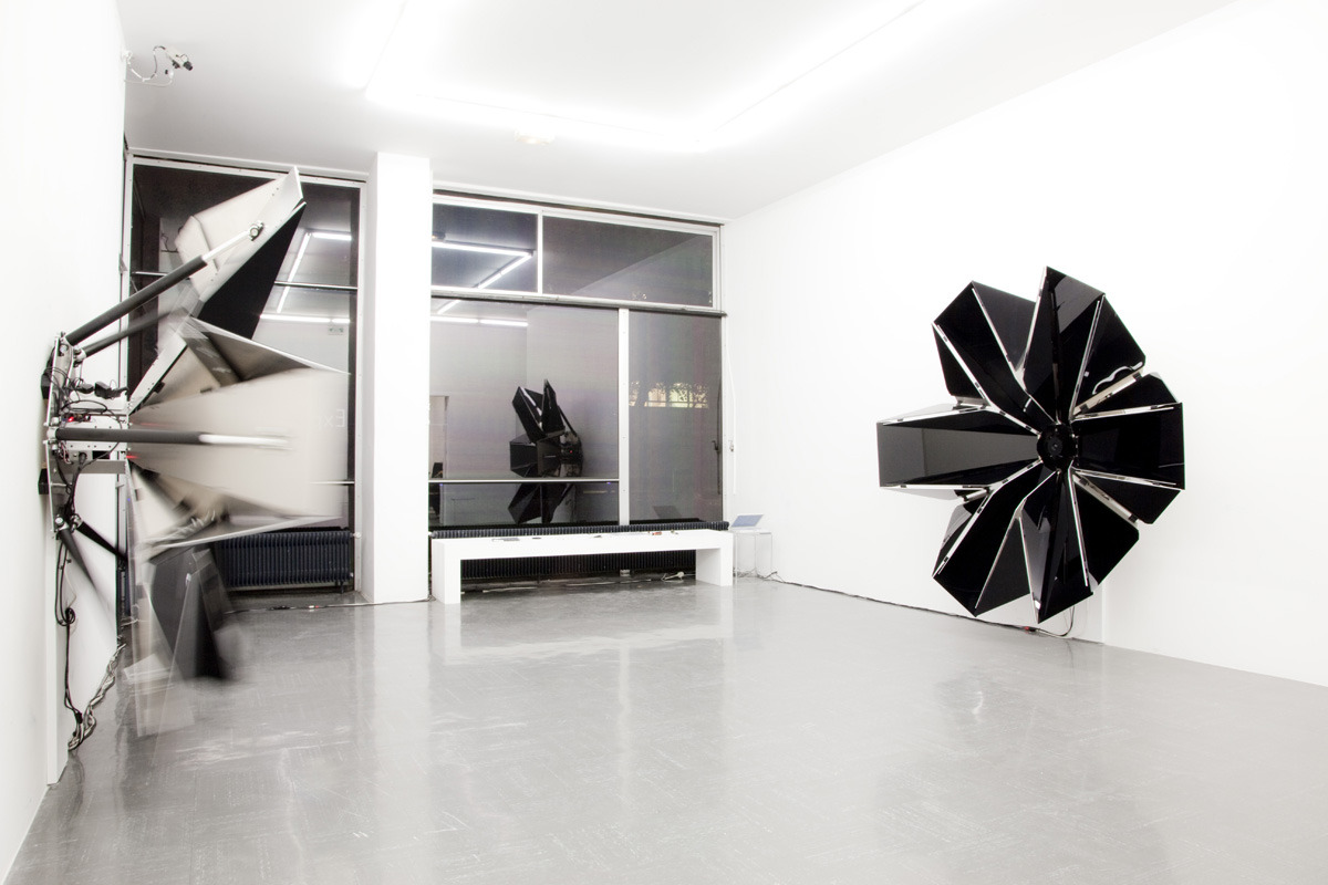 "Versus Kinetic sound installation by David Letellier, 2011. ""Each sculpture is made out of 12 triangular panels, hinged and powered by six linear actuators, controlled by a specific program. At the center of each corolla, a loudspeaker and a microphone allow to play and record sounds."""