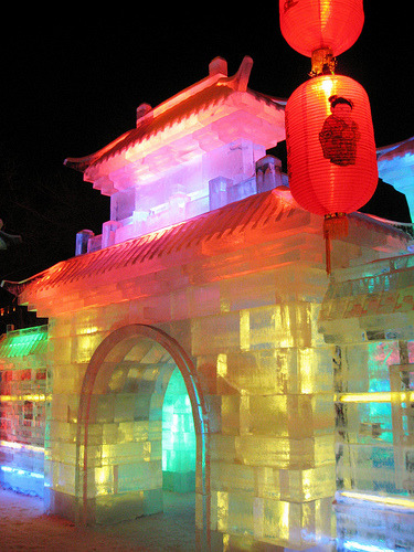somewhereintheworldtoday:  Ice lanterns were a winter-time tradition in northeast China during the Qing Dynasty as the area bears the brunt of the cold winter wind from Siberia with average temperatures as low as -16.8C. The local peasants and fishermen often made ice lanterns to use at night during the winter months and now every year for most of January huge ice blocks are carved into sculptures and buildings to create a glittering Ice and Snow World. As night falls, the gigantic sculptures are illuminated up in a spectrum of colours. More on the Harbin International Ice and Snow Lantern festival by Somewhere in the world today… Picture: Harbin Snow & Ice Festival by Trent Strohm on flickr