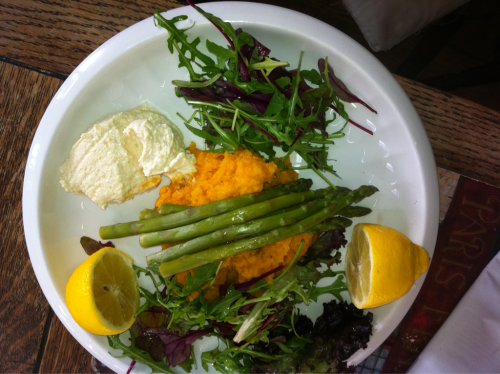 Sweet potato and butternut squash mash, asparagus, hummus, mixed leaves, and lemon.