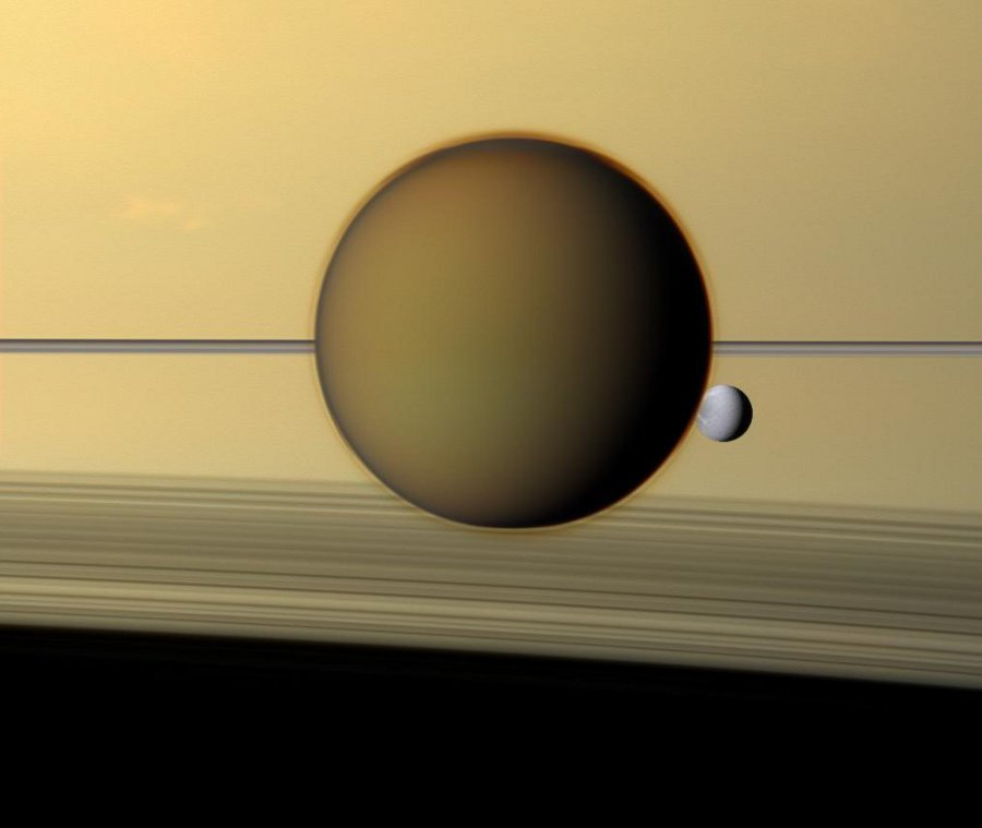 "inothernews:  LOOM WITH A VIEW  This natural color view of Saturn, taken with the red, blue and green spectral filters of the orbiting NASA spacecraft Cassini in May, 2011, shows the rings of Saturn behind Titan, the planet's largest moon, and Dione.  (Photo via NASA APOD)  ""People"" often complain that NASA hasn't done anything productive since sending man to the moon. ""People"" are stupid."