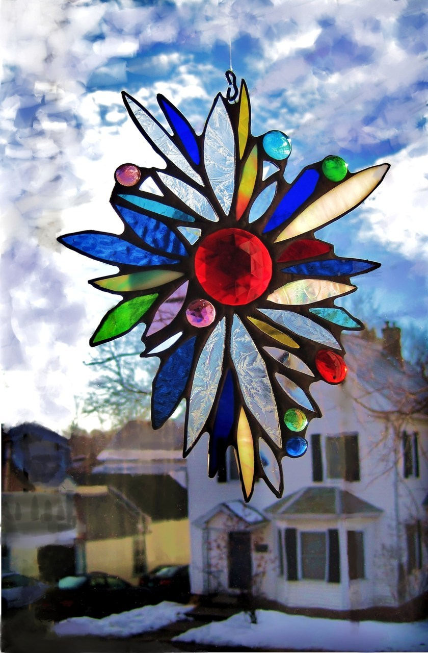 Pretty Peacock sun catcher.