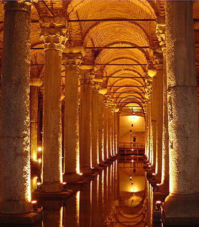 "The Basilica Cistern - also known as ""Yerebatan Sarnıcı"" or The Sunken Palace is the largest  several hundred ancient cisterns that lie beneath the city of Istanbul, Turkey. The cistern was built in the 6th century during the reign of Byzantine Emperor Justinian I. (More information on the Cistern and its history can be found here.) - In the movie ""From Russia With Love"" Kerim Bey, head of Station T (Turkey), keeps a  boat moored on the underground reservoir and daily rows over from a set of underground steps  near his office to an observation post under the Russian consulate where  he had an ex-Royal Navy telescope installed so he can spy on Russian  security meetings."