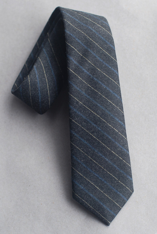 SKU No.  F12-3025 Striped Flannel Tie - Charcoal with Blue & White  Cloth: 100% wool flannelColor: Dark gray with blue and white stripes.