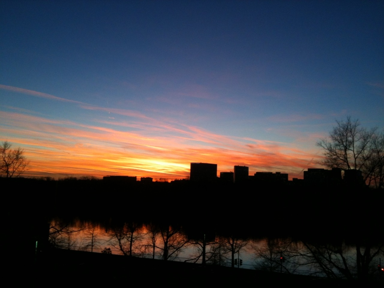 "nationaljournal:  The sunset over the Potomac.  Here at National Journal we talk about sunsets about as much as we discuss politics. Here's the view from my office window (yes, yes, I do have the best view).  Everyone is gathered around my desk. The politics managing editor is writing a sonnet. Our deputy editor is emailing her photo to ""everyone that I know."""