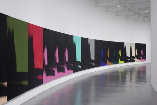 "blakegopnik:  Daily Pic: Some of the 102 ""Shadows"" completed by Andy Warhol in 1978, as seen in a grand sweep along the curved walls of the Hirshhorn Museum, where they're on loan from the Dia Art Foundation. The canvases are apparently based on photos of the shadows cast by random objects in Warhol's studio. An assistant once said they were Warhol's attempt at abstraction, and Warhol playfully referred to them as his disco decor. But when I recently encountered them en masse at the Hirshhorn, they seemed to throb with content. More than anything, they felt cinematic to me, and forensic, like the Zapruder footage of JFK's death. I read them as a record of abstract art's passing. (For a much longer analysis, see the version of my Daily Pic at www.thedailybeast.com/daily-pic.)"
