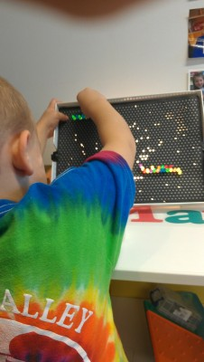 Lite Brite! I put this out in my math and manipulatives center whenever the theme is appropriate, or the mood strikes. I decided to put the lite brite and some blank papers for poking out during Bucket Filling because it is so full of color and life! We also work a lot on patterning (as you will see), so patterning and shape making is so fun with the lite brite! The kids love poking and creating. I even showed a few how to make their names out of light!