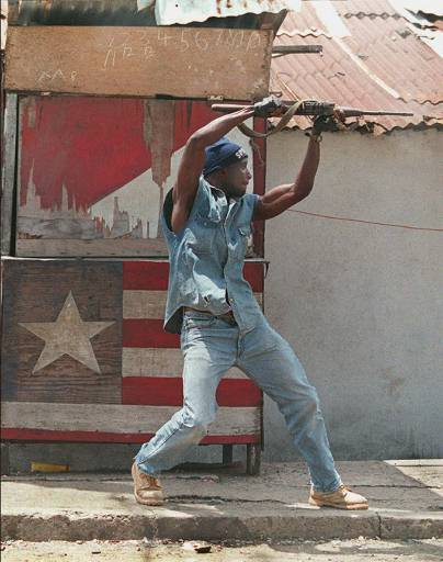 africancivilwarfashions:  Denim never goes out of style. Now if only he could work on that aiming
