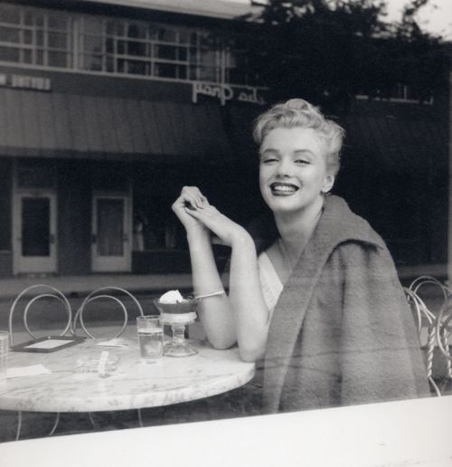 Marilyn at an ice cream parlor, 1953 Photo by Andre De Dienes
