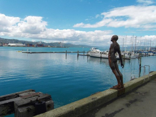 Solace in the Wind, Wellington waterfront. This Max Patte sculpture is two metres high, formed of iron and depicts a naked male diver about to leap. This is one of several permanent public art installations on Wellington waterfront.