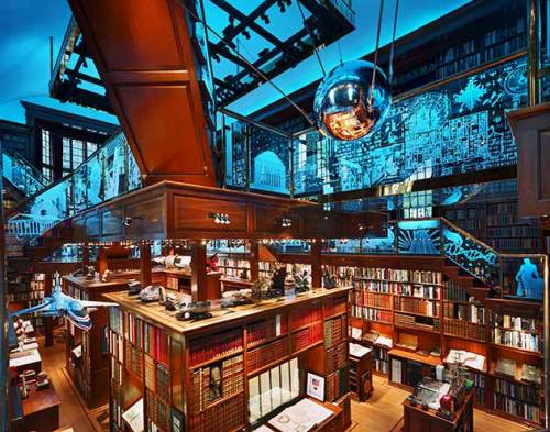 I wish my library was like this decorated with flying planes satelliates and globes