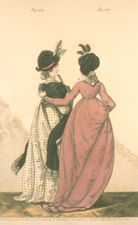 "Gallery of Fashion, Morning Dresses, January 1798.  I'm sorry this scan isn't great, because this is one of those that I desperately wish was clearer!  The pink gown has some nice back seams and they both have on very unusual bonnet.  And do I spy polka dots?! The description describes the pink dress as ""raven-shaded"" and the black trim is made if velvet!"