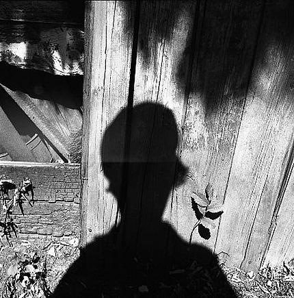 crashinglybeautiful:  Vivian Maier, Self-Portrait (Shadow on Wood) ca. 1960s, Steven Kasher Gallery with thanks to Woods Lot. What makes Maier unique is that her pictures were made for no one, not even herself. They weren't printed at all. They are pure witness. She records but never plays back. Her pictures have no intention but to represent what her curiosity and her feelings demand. That demand must have been pressing indeed, to generate so much meticulous work.