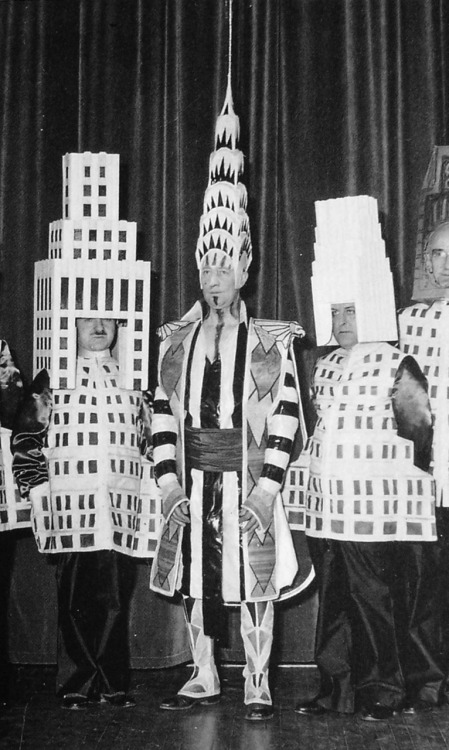 Architects dressed as their buildings  A famous photo from the Society of Beaux-Arts Architects annual ball of  1931 shows [Ely Jacques] Kahn (left of center), Ralph  Walker (dressed  as One Wall Street, right of center), William Van Alen (architect of the  Chrysler Building, center) and others dressed as their most famous  buildings.