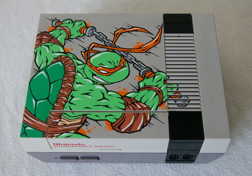 A Little Bit On The Custom Console Side: Custom Teenage Mutant Ninja Turtles NES featuring Michelangelo by OSKUNK.