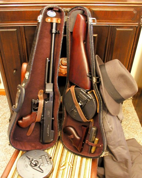 "1928 Tommy Gun in a Violin case 2004 C. G. Anderson: My pride and joy, a Model of 1928 ""Westy"" and custom fitted violin case. And I know it has a Craftsman screwdriver included!"