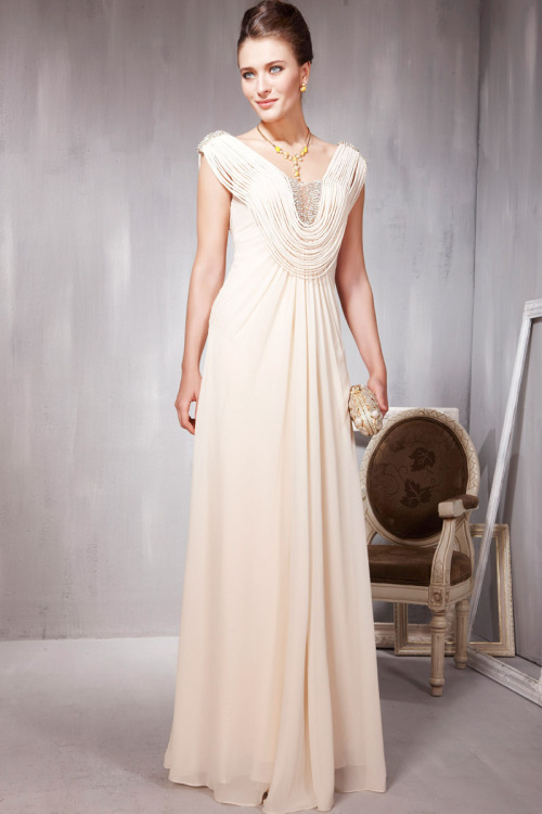 Adorable Cream Toned Evening Dress in Strings  £250.00  Uniquely designed cream toned evening dress featuring full length A Line silhouette with adorable strings as straps attached from the embellished shoulders towards the jewelled bodice forming adorable low cut cowl neckline. Send us a message to inquire about plus sizes or if you want this dress for another colour. :)
