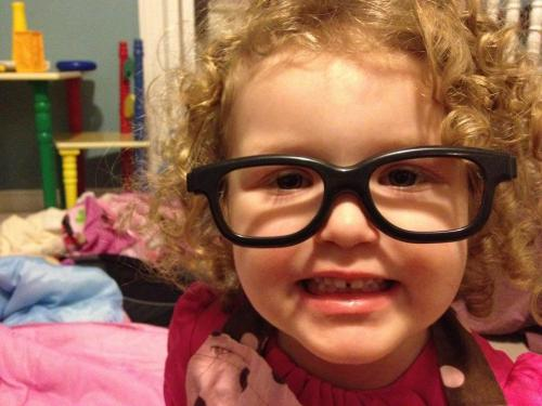 My girl makes her second appearance on Cute Kids With Glasses (I know I've put this photo everywhere. I just love it!) cutekidswithglasses:  Playtime with 3D glasses with the lenses popped out, and mommy's apron.