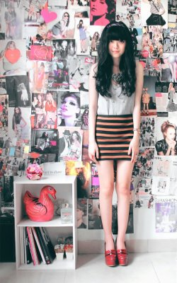 teenvogue:  Take a cue from Fashion Click blogger Sonia Eryka of The Riotous Belle, and add a bright jeweled headband to add an easy pop of color to your 'do. Check out more ways to style the hair accessory here »