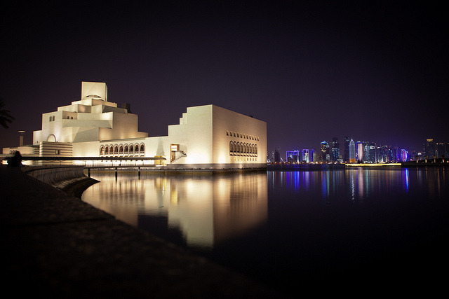 At the Museum of Islamic Art Park on Flickr.Qatar's Museum of Islamic Art glistens in the Doha Bay against a backdrop of the city skyline.