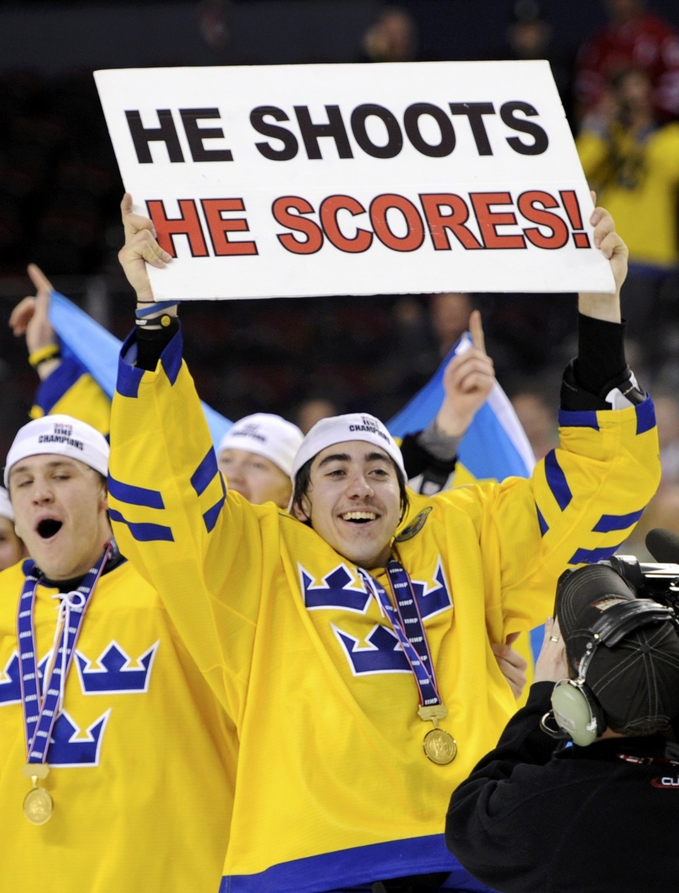 How Swede it isSweden's Mika Zibanejad, who scored the winning goal in overtime, holds a sign while celebrating after defeating Russia in the gold medal game. Photo: REUTERS/Todd Korol