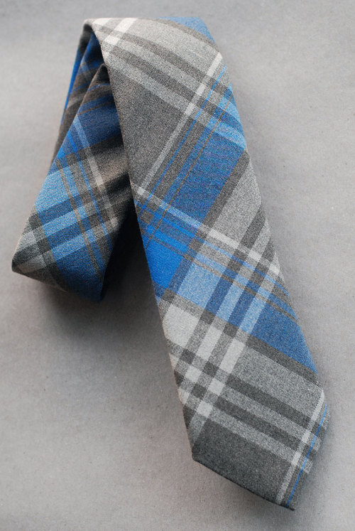 SKU No.  F12-3024 Wool Tartan Tie - Gray, Blue and White  Cloth: Crisp worsted wool plaidColor: Mid gray with bright blue and white checks