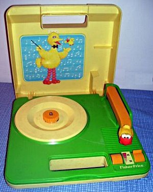 imremembering:  Big Bird Record Player Submitted by Kelsey  i have this in my living room.  the last time i tried it, it didn't work.  i think it needs batteries and/or a new belt.  also one time i brought this and an r. crumb and his cheap suit serenaders record to school in the third or fourth grade to settle a dispute about whether or not saws were musical instruments. my love for the music tapes was predetermined; i was born into it, even though the music tapes were not actually a thing yet when i was born. also i brought this in along with todd rundgren's hermit of mink hollow when we were learning about onomatopoeia in either the fourth or fifth grade.