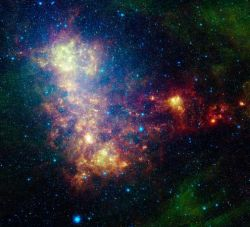 cwnl:  Incredible New Astrophotograph of the Small Magellanic Cloud  A new portrait of the Small Magellanic Cloud reveals our galactic neighbor in unprecedented detail. The picture, taken in infrared light by NASA's Spitzer Space Telescope, is helping astronomers better understand the life cycle of dust in the galaxy.  Understanding where dust comes from, how it forms bodies such as planets, and how it gets dispersed in the spaces between objects can result in new insights into galaxy formation. And the Small Magellanic Cloud, a dwarf galaxy close to the Milky Way, is an analog for some of the tiny galaxies that first populated the universe.  Image courtesy NASA, JPL-Caltech, STScI
