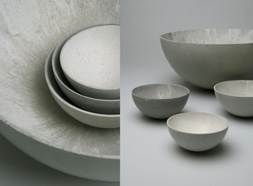 """Setting a minimalist accent, this set of four hand-made bowls presents an apparently everyday material in a new context. The bowls have a mobile quality; playing with the usual cliché of the hard rigidity and weight of concrete; they can rock back and forth, while drawing their stability from the increasing wall thickness towards the base."""