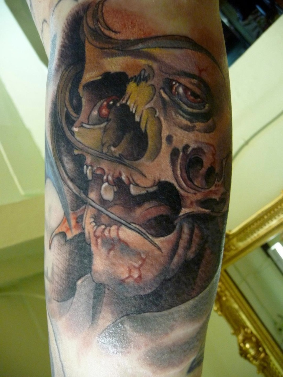 Tattoo By Damon Conklin. Super Genius Tattoo.