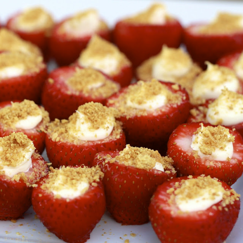 Cheesecake Stuffed Strawberries Ingredients: -1 lb large strawberries -8 oz. cream cheese, softened (can use 1/3 less fat) -3-4 tbsp powdered sugar (4 tbsp for a sweeter filling) -1 tsp vanilla extract -graham cracker crumbs Directions: 1. Rinse strawberries and cut around the top of the strawberry. Remove the top and clean out with a paring knife, if necessary (some may already be hollow inside). Prep all strawberries and set aside. 2. In a mixing bowl, beat cream cheese, powdered sugar, and vanilla until creamy. Add cream cheese mix to a piping bag or ziploc with the corner snipped off. Fill strawberries with cheesecake mixture. Once strawberries are filled, dip the top in graham cracker crumbs. If not serving immediately, refrigerate until serving.