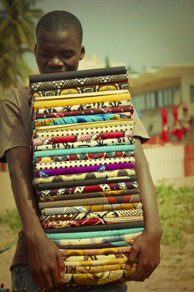 kilele:  Textile Vendor in Maputo, Mozambique Photo by Paty Jimenez