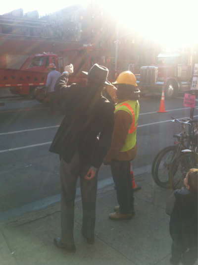 Mr. Siegel directs the crane operator