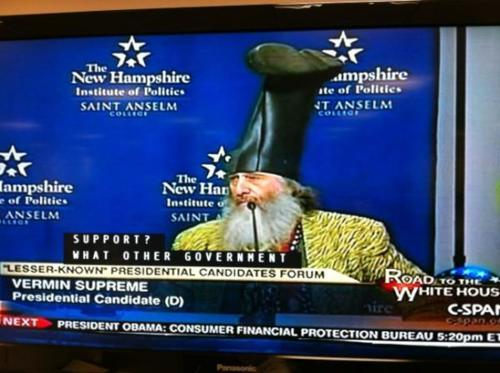 religiousragings:  iheartchaos:  Meet Vermin Supreme, Democratic candidate for president of the United States And yes, that's a rubber boot on his head. Mr. Supreme is the only candidate that supports going back in time and killing Hitler before he was born and making tooth brushing mandatory. Vermin Supreme's official website Via  If it comes down to a race between this guy and any of the Republicans, this guy gets the vote. And I could stand by a Constitutional Tooth Brushing amendment.